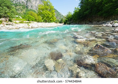 Mountain river with clean blue water. Selective focus.