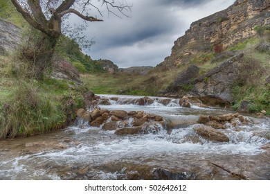 Mountain river in cloudy day