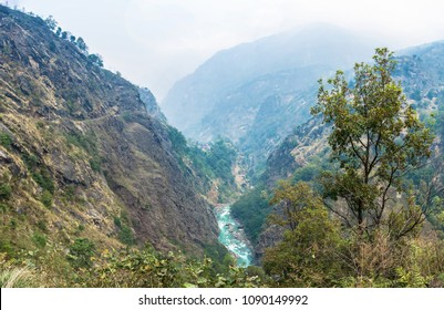 Mountain river in a deep gorge on a spring day, Himalayas, Nepal.