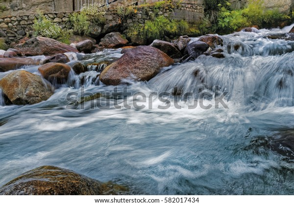 Mountain River Dzhilgysu, in the mountainous village of Eltyubyu (formerly Upper Chegem), Russia, the North Caucasus.