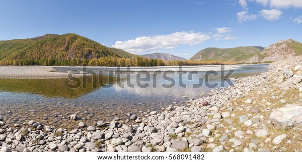 Mountain river in the Eastern Sayan Mountains. Panorama.  Autumn landscape