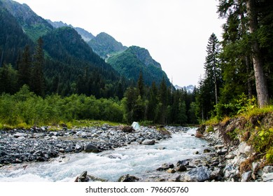 The mountain river. A fast mountain river. The Green Valley. Clean stormy river. Summer. Caucasian ridge.