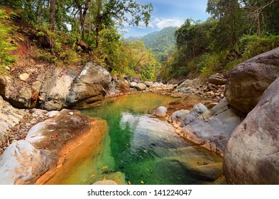 Mountain river in the Himalayas flows among the rocky stones steep shores. Uttarakhand, India