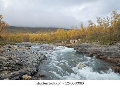 Mountain river landscape in autumn. Abisko national park in Sweden.