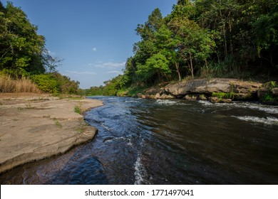 Mountain river with stones. Fast water current. Water photo texture. Grey river in tropics wallpaper. Rafting river in forest. Splashy fast river texture. Natural water texture. Fresh spring top view