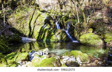 mountain river and stones overgrown with moss