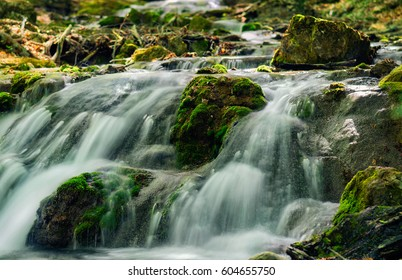 Mountain river with stones with pure thawed water.  Spring bright background.