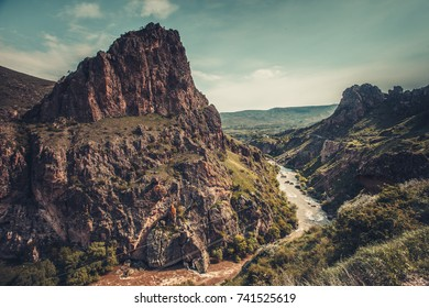 Mountain river stream in canyon valley. Panoramic Nature landscape. Travel background. Holiday, hiking, sport, recreation. Retro vintage toning effect.