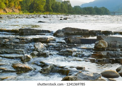Mountain river in sunset time. Front view on the valley of river Opir in Carpathians.