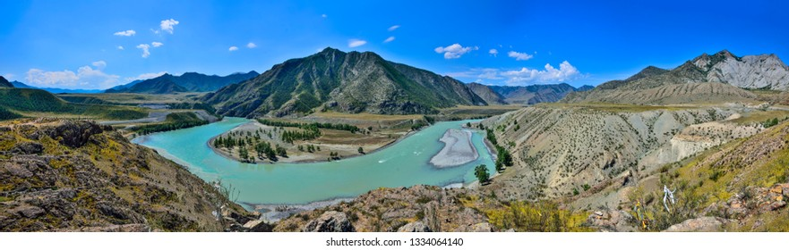 Сonfluence of the mountain rivers Chuya and Katun. Bend of the turquoise Katun River in a mountain valley - beautiful panoramic view from the colorful rocks,  Altai republic, Russia