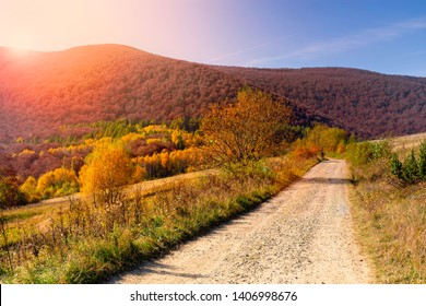 Mountain road in autumn in the rays of the sunset.  Bieszczady National Park - Poland
