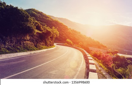 Mountain road. beautiful asphalt road in the evening in summer during sunset. Vintage toning. Travel background. Highway in mountains. Meteora Region. Greece