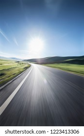 Mountain road and beautiful grassland scenery