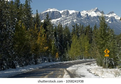 Mountain road covered with September snow west of Banff, Alberta Canada