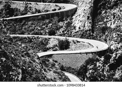 Mountain road curves for cyclist in Mallorca closeup. Outdoors sports landscape