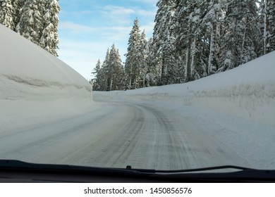 Mountain road highway 88 towards Carson Pass, California, USA, on a winters day featuring five feet of snow on the side of the road after several storms,