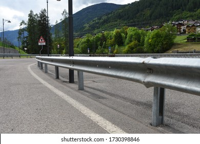 mountain road with iron guardrail