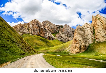 Mountain road landscape. Mountain canyon road landscape. Cloudy sky in mountain valley
