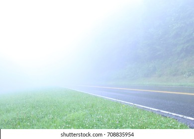 Mountain Road Leading Off into Mist