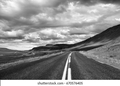 Mountain road next to Hvalfjordur fiord in Iceland. Black and white vintage style.