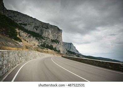 Mountain road in overcast day. Wide angle view. Crimea.