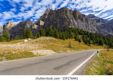 Mountain road from Passo Gardena to Passo Sella in autumn season, Dolomites Mountains, South Tyrol, Italy