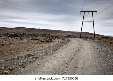 Mountain road and power pylon in Iceland