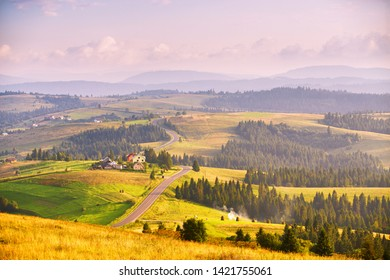 Mountain road at summer sunset. Curved asphalt road on top of the hills. Pieniny and  Beskidy range, border of Poland and Ukraine.