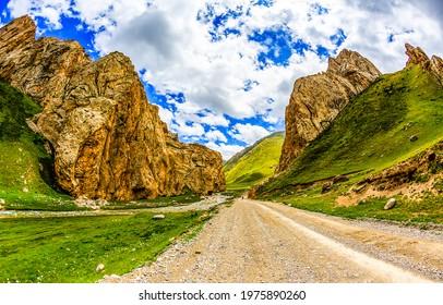 Mountain road through the canyon. Mountain road landscape. Rocks at mountain road. Road in mountains