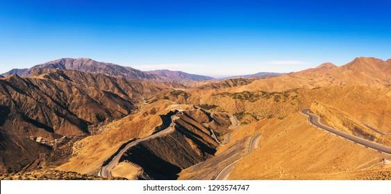 Mountain road through the Tizi-n-Tichka pass in the Atlas Mountains, Morocco. This mountain pass is connecting Marrakesh to the city of Ouarzazate.