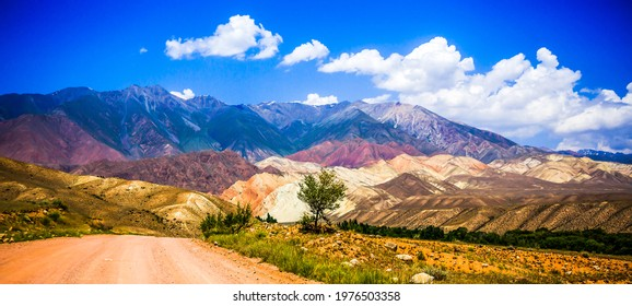 Mountain road through the valley panorama. Mountain valley panorama. Beautiful mountain valley landscape. Mountain valley panoramic landscape - Shutterstock ID 1976503358