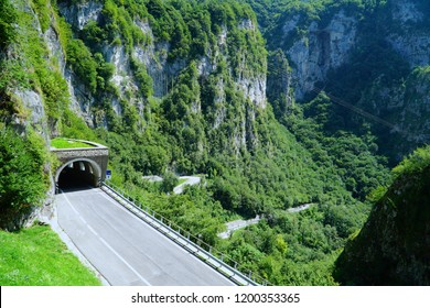 Mountain road in Veneto, Italy. The entrance to the tunnel. Veneto is a northeastern Italian region stretching from the Dolomite Mountains.