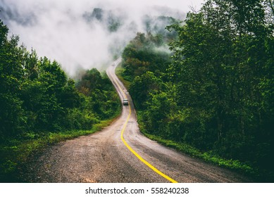 Mountain roads and fog cover over the top of Doi Ang Khang, Chiang Mai, Thailand.The route is beautiful.Nature background.