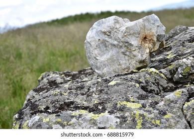 Mountain rocks  rocks and green grass