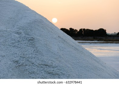 Mountain of salt and the sun goes down by its hill side