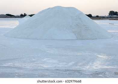 Mountain of salt at sunrise on a white floor