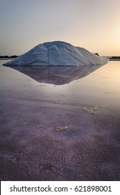 Mountain of salt  at sunrise. Salt and water creates a powerful image to photograph