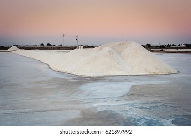 Mountain of salt at sunset. Salt and water creates a powerful image to photograph