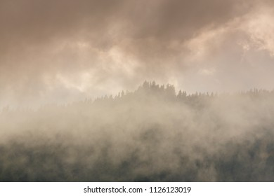 Mountain scenery in the Alps with mist and fog