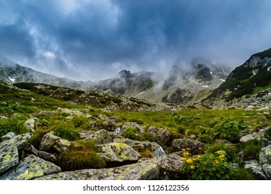 Mountain scenery in the  Alps in summer, with rain clouds, mist and fog