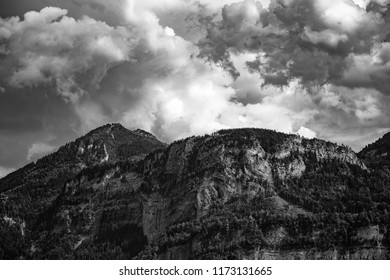 A mountain scenery close to Bregen in Austria with dramatic clouds