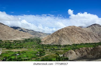 Mountain scenery with green valley at sunny day in Ladakh, India.