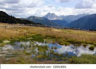 Mountain scenery of a small lake in Italy with beautiful clouds