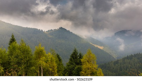 Mountain scenery in the Transylvanian Alps in autumn, with mist clouds