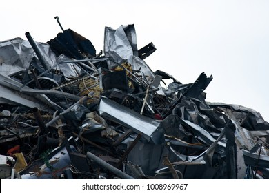 Mountain of scrap metal - predominantly ferrous metals. Enterprise for collection of scrap metal. Waste from industry and household