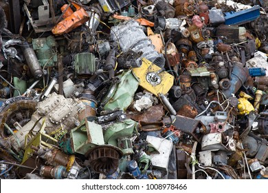 Mountain of scrap metal - predominantly ferrous metals. Enterprise for collection of scrap metal. Large number of old motors, engines, electromotors, industrial waste, metal recycling