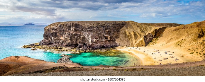 Mountain sea bay beach panorama. Sea bay beach panoramic landscape. Sandy beach at sea bay. Sea bay beach panorama