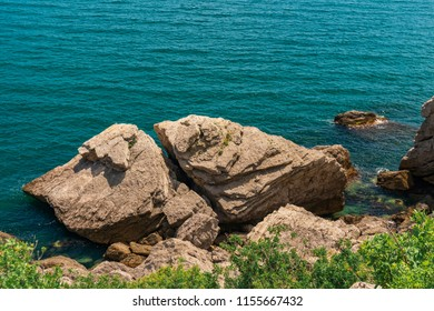 Mountain sea bay rocks panoramic landscape. Sea bay rocks view in mountains. Mountain sea bay rock cliff view