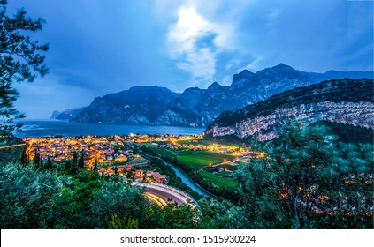 Mountain sea town, landscape with stormy sky. Mountain sea town stormy sky panorama. Stormy sky over mountain sea town. Mountain sea town in evening