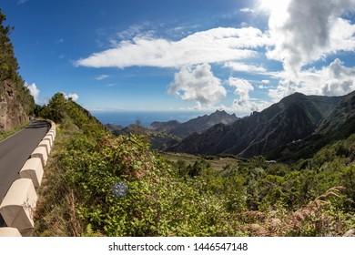 Mountain serpentine. Narrow winding road. The path from Taganana village to Santa Cruz de Tenerife. Stunning view from above. Fish eye lens shot. Tenerife, Canary Islands, Spain.